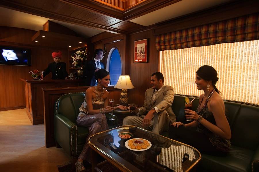 Guests enjoying a leisurely evening in the Rajah Club - Maharajas Express
