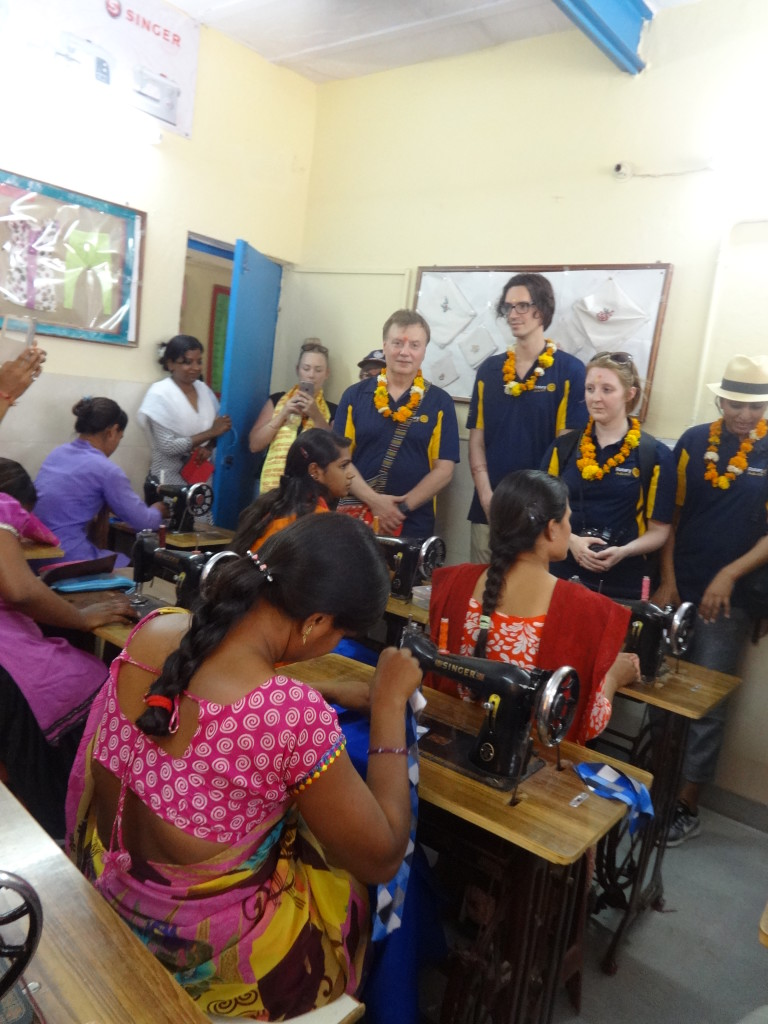 rotary tour guest in tailoring class