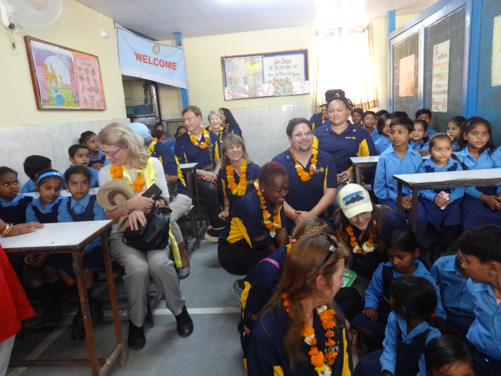 rotary tour guests with children